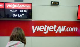 Ceck in - VietjetAir - Can Tho. Traveler girl  at Can-tho Airport - check in Vietjet December 2016 - Vietnam Stock Photo
