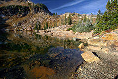 Cecret Lake reflections in Utah. Cecret Lake is located in Utah.  This photo contains rocks mountains and reflections from the lake Royalty Free Stock Photo