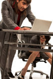 Cecretary under desk flirting with collegue Stock Photo