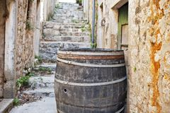 Cedar barrel in a narrow street Stock Images