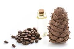 Cedar Cone, Branches And Cedar Oil On White. Close Up. Copy Space. Stock Photo