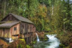 Cedar Creek Grist Mill in Washington State. Listed on the national Register of Historic Places, Cedar Creek Grist Mill is a water-powered mill.  It was built in Royalty Free Stock Image