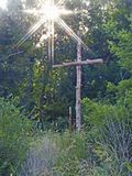 Cedar Cross with Sun beams to brighten the way. Cedar Cross at the entrance of a driveway in Oklahoma accented with the sunbeams of the sunshine stock image