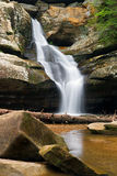 Cedar Falls in the Hocking Hills. Cedar Falls, a waterfall flowing with spring rains in Ohio's Hocking Hills State Park royalty free stock photo