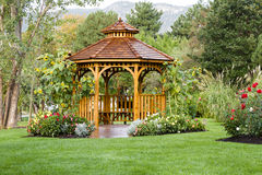 Cedar Gazebo Backyard Garden Park. Cedar gazebo in city park Royalty Free Stock Images