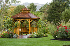 Cedar Gazebo Backyard Garden Park. Cedar gazebo in city park Stock Images