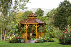 Cedar Gazebo Backyard Garden Park. Cedar gazebo in city park Royalty Free Stock Image