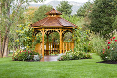 Cedar Gazebo Backyard Garden Park. Cedar gazebo in city park Royalty Free Stock Photos