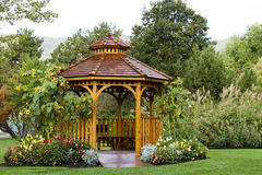 Cedar Gazebo Backyard Garden Park. Cedar gazebo in city park Royalty Free Stock Photo