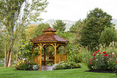 Cedar Gazebo Backyard Garden Park. Cedar gazebo in city park Stock Image