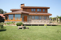 Cedar house. Beautiful cedar house with garden Royalty Free Stock Photography
