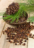 Cedar nuts with pine cones Royalty Free Stock Photos