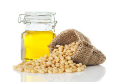 Cedar oil in a glass jar and peeled pine nuts Royalty Free Stock Photography