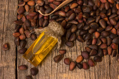 Cedar oil and nuts Stock Photo