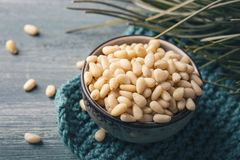 Cedar pine nuts. In a wooden spoon royalty free stock photography