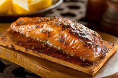 Cedar Planked Salmon. A single serving portion of delicious cedar smoked salmon Royalty Free Stock Photography
