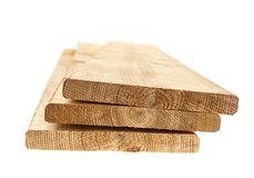 Cedar planks. Three cedar one by six inch wood planks on white background Royalty Free Stock Images