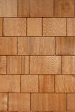 Cedar Shakes Background. Exterior Home Wall Covered in New Wooden Cedar Shakes or Shingles. Warm colors with nice details and textures Royalty Free Stock Photo