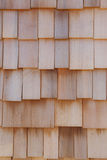 Cedar Shingle Background. A photo of cedar siding on an exterior wall that is suitable for use as a background or texture Royalty Free Stock Photography