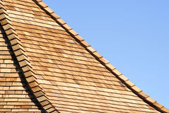 Cedar Shingles. Layers of new cedar shingles on a roof Stock Image