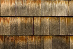 Cedar Shingles. Close-up of weathered and worn cedar siding shingles. Nice texture image for a background Stock Image