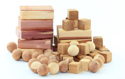 Cedar Wood Blocks and Balls. Pile of cedar wood blocks, cubes, and balls; white background. Cedar wood is used as moth and insect repellent for cabinets and Stock Photos
