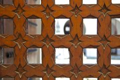 Cedar wood carved Moroccan door. Courtyard of Al Karaouine Koran University Door viewed through the Moroccan Cedar Wood Carved Door of the Al Karaouine Koran Stock Images