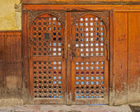 Cedar wood carved Moroccan door. Courtyard of Al Karaouine Koran University Door viewed through the Moroccan Cedar Wood Carved Door of the Al Karaouine Koran Royalty Free Stock Photo