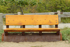 Cedar Wooden Park Bench on the Beach Royalty Free Stock Photography