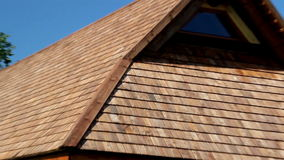 The cedar wooden shingle rooftop of the small log house stock footage