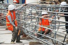 Cedazo chino de la construcción del trabajador Foto de archivo libre de regalías