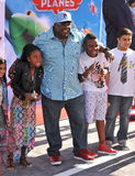 Cedric the Entertainer. LOS ANGELES, CA - AUGUST 5, 2013: Cedric the Entertainer & family at the world premiere of his movie Disney's Planes at the El Capitan Royalty Free Stock Photo