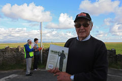 Cedric Robinson with his book at Morecambe Bay. KENTS BANK, UNITED KINGDOM - JULY 29: Mr. Cedric Robinson MBE, official UK Queens Guide to the Sands and author Stock Photo