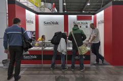 CEE 2016 exhibition of electronics in Kiev, Ukraine. Unrecognized people visit SanDisk, American electronics manufacturer company booth during CEE 2016, the Royalty Free Stock Images