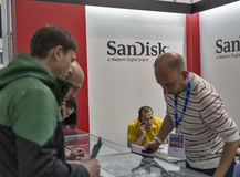 CEE 2016 exhibition of electronics in Kiev, Ukraine. Unrecognized people visit SanDisk, American electronics manufacturer company booth during CEE 2016, the Stock Photos