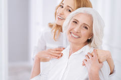 Ceerful aged woman embracing with her daughter Royalty Free Stock Photography