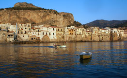 Cefalu. Old town Cefalù in Sicily at summer - littles boats in the sea royalty free stock image