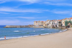 Cefalu beach in Sicily. Swimmers at cefalu beach in sicily stock photo