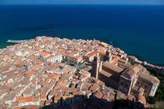 Cefalu Catherdral and old town. Bird's eye view of Cefalu catherdral and closely packed roofs in Cefalu old town Stock Image