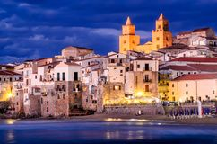 Cefalu coastline, Sicily, Italy. Night view of Cefalu old city of Sicily, Italy, norman medieval architecture royalty free stock photos