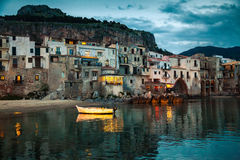 Cefalu at dusk. Harbor view of old houses in Cefalu at dusk, Sicily Royalty Free Stock Image