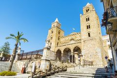Cathedral of Cefalu in Sicily, Italy. Cefalu, Italy - August 8, 2017: Facade of the cathedral of Cefalu, of style called Sicilian Romanesque, with people around Royalty Free Stock Images