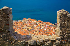 Cefalu old houses through the bastion's wall Stock Image