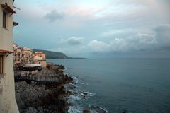 Cefalu Panorama, Sicily. Looking along a seafront of apartments and restaurants in Cefalu, Sicily. These front onto the Tyrrhenian coast of Sicily. The city of stock images