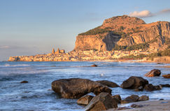 Cefalu rock and historical town Stock Photos