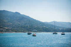 Cefalu sea view in Sicily. Cefalu sea view with boats, beach, mountain and trees in Sicily, Italy Royalty Free Stock Photo