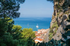 Cefalu sea view in Sicily. Cefalu sea view with boats, old town roofs, mountain and trees in Sicily, Italy Royalty Free Stock Photos