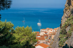 Cefalu sea view in Sicily. Cefalu sea view with boats, old town roofs, mountain and trees in Sicily, Italy Royalty Free Stock Image