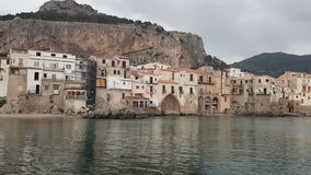 Timelapse of historical Cefalu Sicily from the harbour at evening
