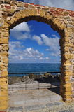 Cefalu, Sicily, Italy. Stone arch gate, Mediterranean sea view Stock Photography